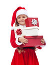 Little girl in santa costume holding presents happy christmas isolated Royalty Free Stock Images