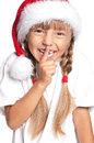 Little girl in Santa hat Stock Image