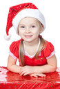 Little girl in santa hat with gift on white Stock Photo