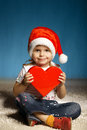 Little girl with santa hat with heart cute Royalty Free Stock Photos