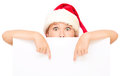 Little girl in santa hat is holding blank board Royalty Free Stock Photo
