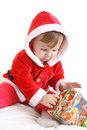 Little girl in santa's clothes with present Stock Photo