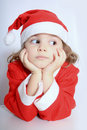Little girl in Santa's hat Stock Photos