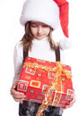 Little girl with santa's hat and gift holding Royalty Free Stock Photo