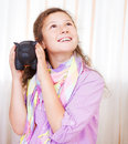 Little girl saving money in a piggybank Stock Photo