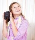 Little girl saving money in a piggybank Stock Photo