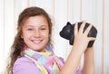 Little girl saving money in a piggybank Stock Image