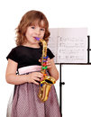 Little girl with saxophone Stock Photography