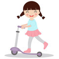Little girl on scooter Royalty Free Stock Photos