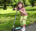 Little girl with scooter Royalty Free Stock Photos