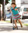 Little girl with scooter Royalty Free Stock Photo