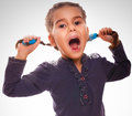 Little girl screaming child opened her mouth isolated on white background gray Stock Photos