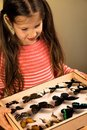 Little Girl Scrutinizes Entomology Collection of Tropical Butterflies Royalty Free Stock Photo
