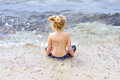 Little girl watching the ocean Royalty Free Stock Photo
