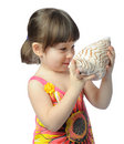 Little girl with seashell Stock Photo