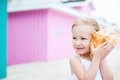 Little girl with seashell Royalty Free Stock Photos