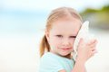 Little girl with a seashell Royalty Free Stock Image