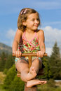 Little girl on the seesaw Stock Photos