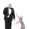 Little girl and servant in tuxedo have fun on white background Stock Images