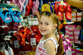 Little girl in a shoe store Royalty Free Stock Photo