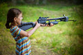 Little girl shooting crossbow Royalty Free Stock Photo