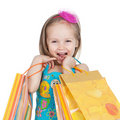 Little girl with shopping bags Stock Photos
