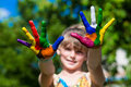 Little girl showing painted hands, focus on hands. Hand prints Royalty Free Stock Photo