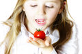 Little girl showing small red tomato Royalty Free Stock Photo