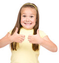Little girl is showing thumb up gesture dressed in blue using both hands isolated over white Stock Photography