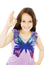Little girl shows sign okay isolated on a white background Royalty Free Stock Images