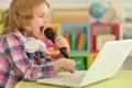 Little girl singing karaoke Royalty Free Stock Photo