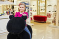 Little girl sits on big stuffed toy in clothing store Stock Images