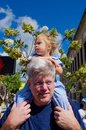 Little girl sits her grandpa s shoulders best view parade valparaiso popcorn fest Stock Image