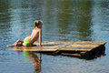 Little girl sits on a raft Stock Photo