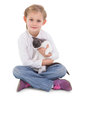 Little girl sitting with cat in her arms Royalty Free Stock Photo