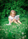 Little girl sitting with computer outdoors Royalty Free Stock Images