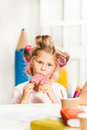 Little girl sitting and eating ice cream Royalty Free Stock Photo