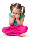 Little girl is sitting on floor and crying Royalty Free Stock Photo