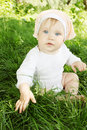 Little girl sitting fresh grass Royalty Free Stock Images