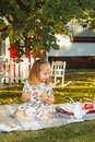 The little girl sitting on green grass Royalty Free Stock Photo