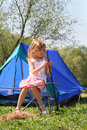 Little girl sitting near tent on nature Royalty Free Stock Image