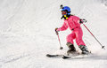 Little Girl Skiing Fast Downhill