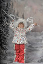 Little girl with skis in hand on background of a winter landscape Stock Image