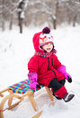 Little girl on sled Stock Photo