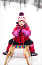 Little girl on sled Royalty Free Stock Photo