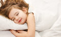 Little girl sleep in the bed close-up Royalty Free Stock Image