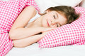 Little girl sleeping in bed Stock Photo