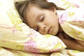 Little girl sleeping portrait of a in her bed Royalty Free Stock Photo