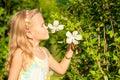 Little girl smelling flower Royalty Free Stock Photo