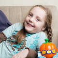 Little girl smiling at home lying on a couch looking the camera Royalty Free Stock Photos